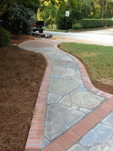 Stone and Brick walkway constructed by American Craftsman Renovations.